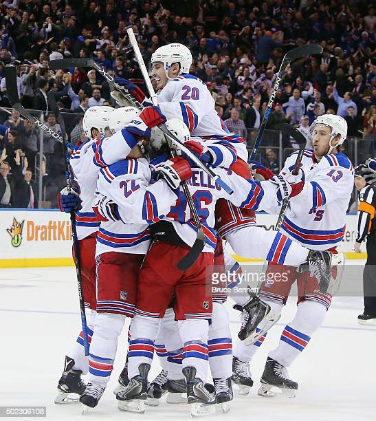 The New York Rangers celebrate a 32 overtime win over the Anaheim Ducks at Madison Square Garden on December 22 2015 in New York City