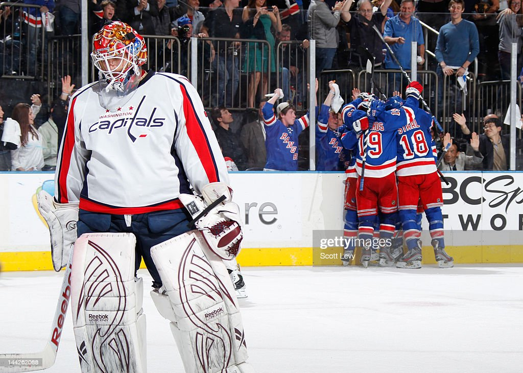 The New York Rangers celebrate a goal against <a gi-track='captionPersonalityLinkClicked' href=/galleries/search?phrase=Braden+Holtby&family=editorial&specificpeople=5370964 ng-click='$event.stopPropagation()'>Braden Holtby</a> #70 of the Washington Capitals in Game Seven of the Eastern Conference Semifinals during the 2012 NHL Stanley Cup Playoffs at Madison Square Garden on May 12, 2012 in New York City. The Rangers defeat the Capitals 2-1.