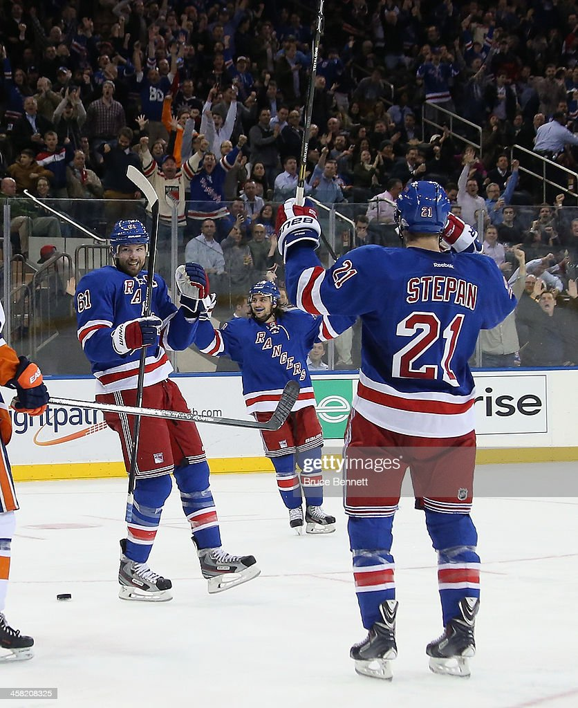 The New York Rangers celebrate a powerplay goal by <a gi-track='captionPersonalityLinkClicked' href=/galleries/search?phrase=Derek+Stepan&family=editorial&specificpeople=4687181 ng-click='$event.stopPropagation()'>Derek Stepan</a> #21 (R) at 7:58 of the second period against the New York Islanders at Madison Square Garden on December 20, 2013 in New York City.