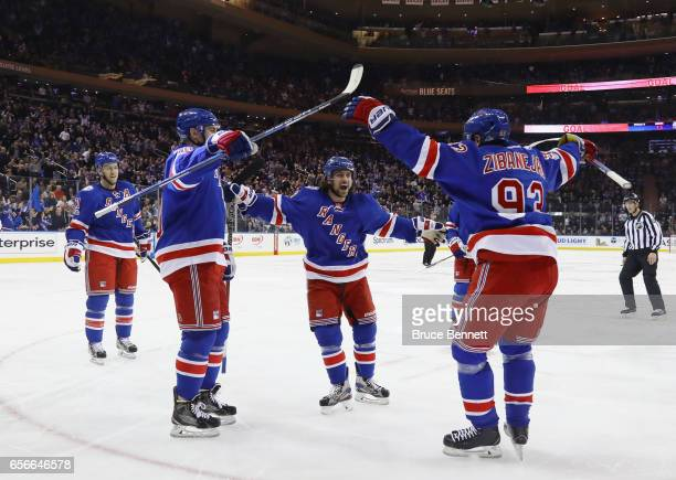 The New York Rangers celebrate a powerplay goal by Mats Zuccarello at 236 of the second period against the New York Islanders at Madison Square...