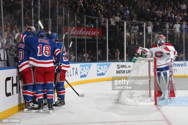 The New York Rangers celebrate a third period goal by Mika Zibanejad against Carey Price of the Montreal Canadiens at Madison Square Garden on...