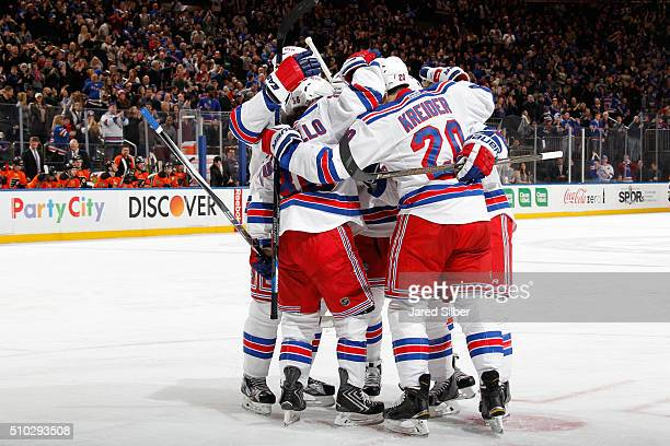 The New York Rangers celebrate after a goal by Derek Stepan in the third period against the Philadelphia Flyers at Madison Square Garden on February...