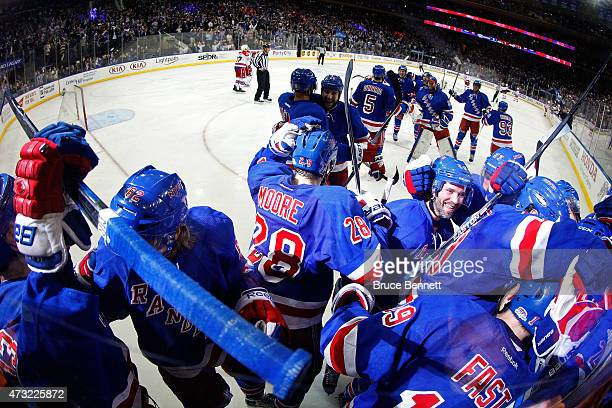 The New York Rangers celebrate after winning Game Seven of the Eastern Conference Semifinals against the Washington Capitals on a game winning goal...
