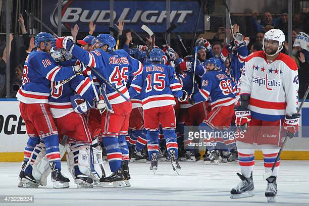 The New York Rangers celebrate after winning in overtime to advance to the Eastern Conference Finals against the Washington Capitals in Game Seven of...