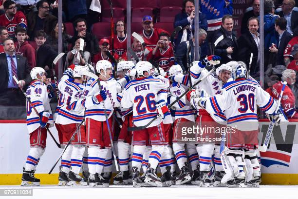 The New York Rangers celebrate an overtime victory against the Montreal Canadiens in Game Five of the Eastern Conference First Round during the 2017...
