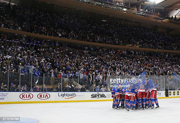 The New York Rangers celebrate the game winning goal by Carl Hagelin at 1052 of overtime against the Pittsburgh Penguins in Game Five of the Eastern...