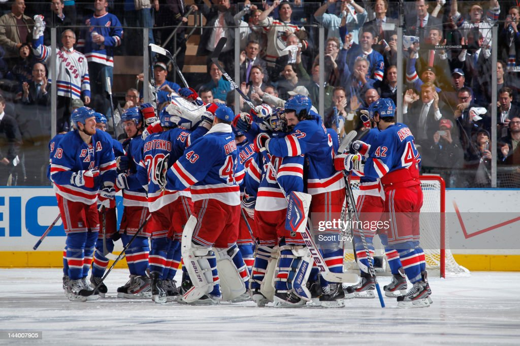 The New York Rangers celebrate the win against the Washington Capitals in Game Five of the Eastern Conference Semifinals during the 2012 NHL Stanley Cup Playoffs at Madison Square Garden on May 7, 2012 in New York City. The Rangers defeat the Capitals 3-2 in overtime.