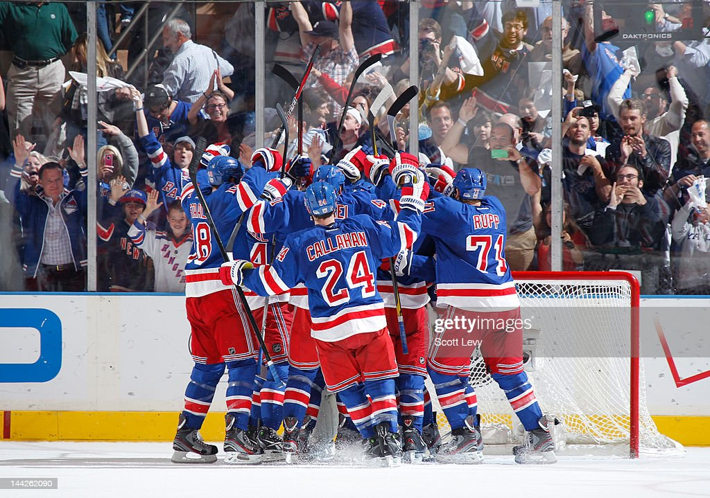The New York Rangers celebrate the win against the Washington Capitals in Game Seven of the Eastern Conference Semifinals during the 2012 NHL Stanley Cup Playoffs at Madison Square Garden on May 12, 2012 in New York City. The Rangers defeat the Capitals 2-1.