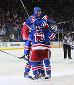 The New York Rangers celebrate their 21 overtime victory over the Washington Capitals in Game Five of the Eastern Conference Semifinals during the...