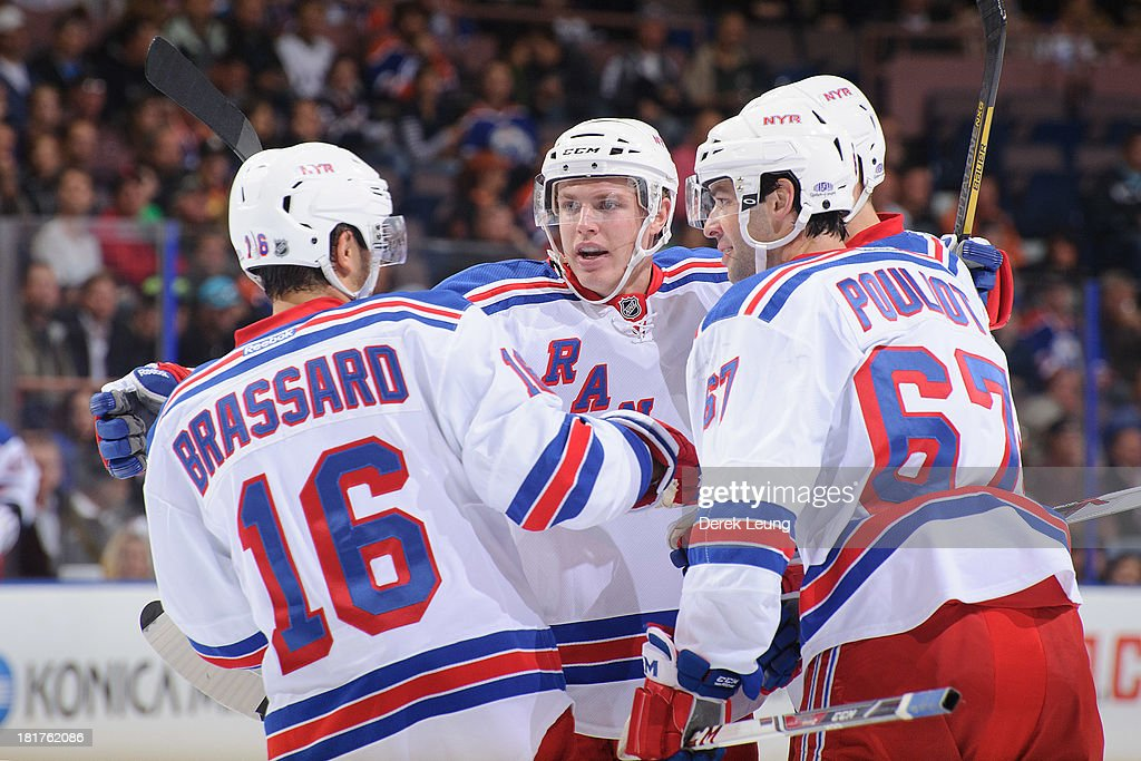 The New York Rangers celebrate their first period goal scored by Marc Staal #18 against the Edmonton Oilers during a preseason NHL game at Rexall Place on September 24, 2013 in Edmonton, Alberta, Canada.