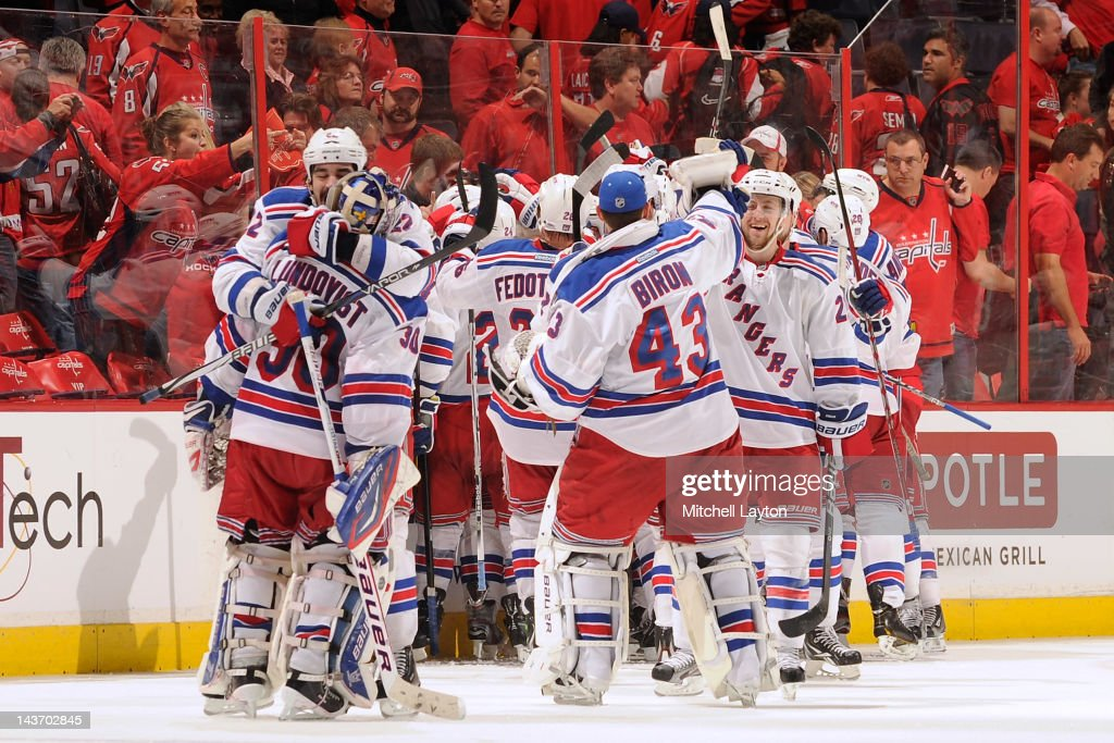 The New York Rangers celebrate their win of Game Three of the Eastern Conference Semifinals of the 2012 NHL Stanley Cup Playoffs against the Washington Capitals at the end of the third overtime on May 3, 2012 at the Verizon Center in Washington, DC.