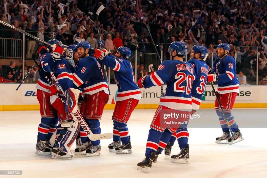 The New York Rangers celebrate with goalie <a gi-track='captionPersonalityLinkClicked' href=/galleries/search?phrase=Henrik+Lundqvist&family=editorial&specificpeople=217958 ng-click='$event.stopPropagation()'>Henrik Lundqvist</a> #30 of the New York Rangers after they won 2-1 against the Washington Capitals in Game Seven of the Eastern Conference Semifinals during the 2012 NHL Stanley Cup Playoffs at Madison Square Garden on May 12, 2012 in New York City.