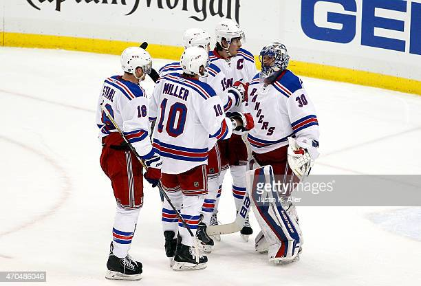 The New York Rangers celebrate with Henrik Lundqvist after defeating the Pittsburgh Penguins 21 in Game Three of the Eastern Conference Quarterfinals...