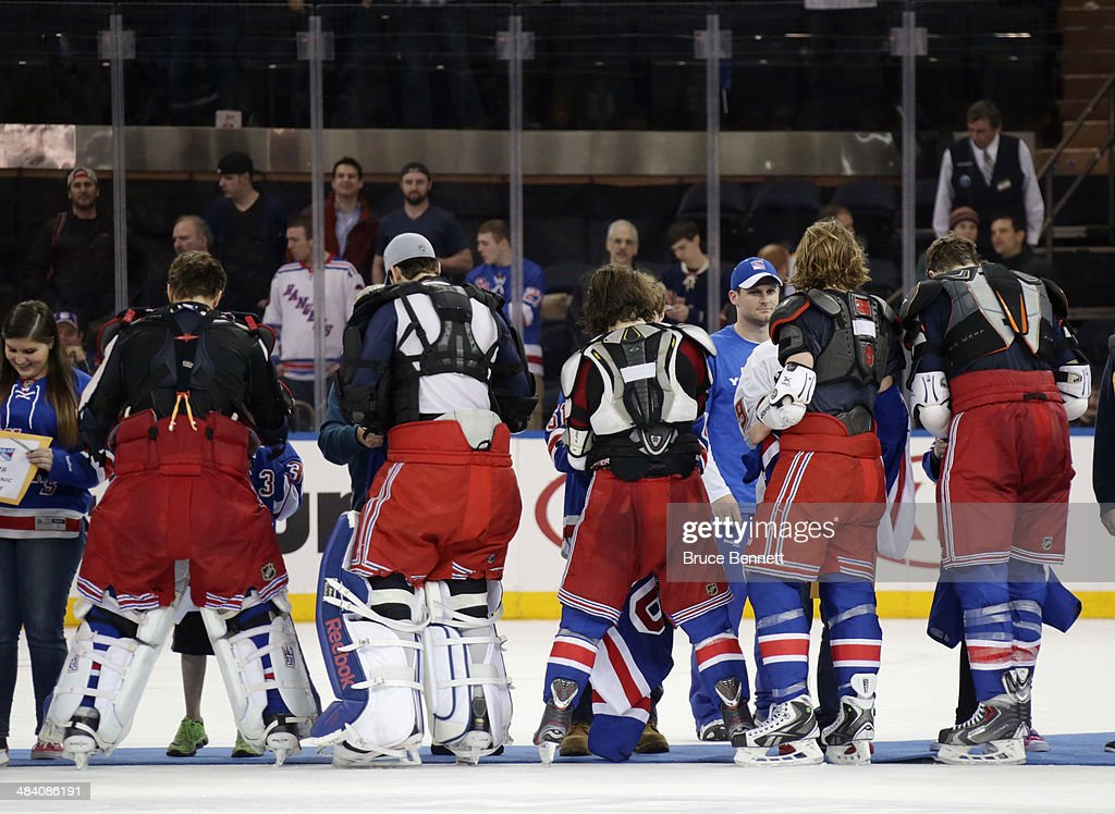 The New York Rangers give their game jerseys to fans following their last regular season game against the Buffalo Sabres at Madison Square Garden on April 10, 2014 in New York City. The Rangers defeated the Sabres 2-1.