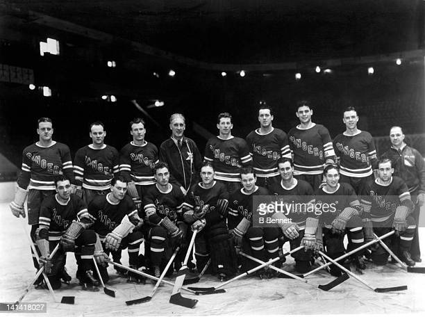 The New York Rangers pose for the team portrait circa 1938 at the Madison Square Garden in New York New York Top row Lynn Patrick coach Lester...