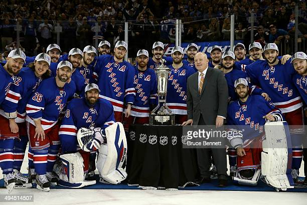 The New York Rangers pose with Deputy Commissioner Bill Daly and the Prince of Wales Trophy after defeating the Montreal Canadiens in Game Six to win...