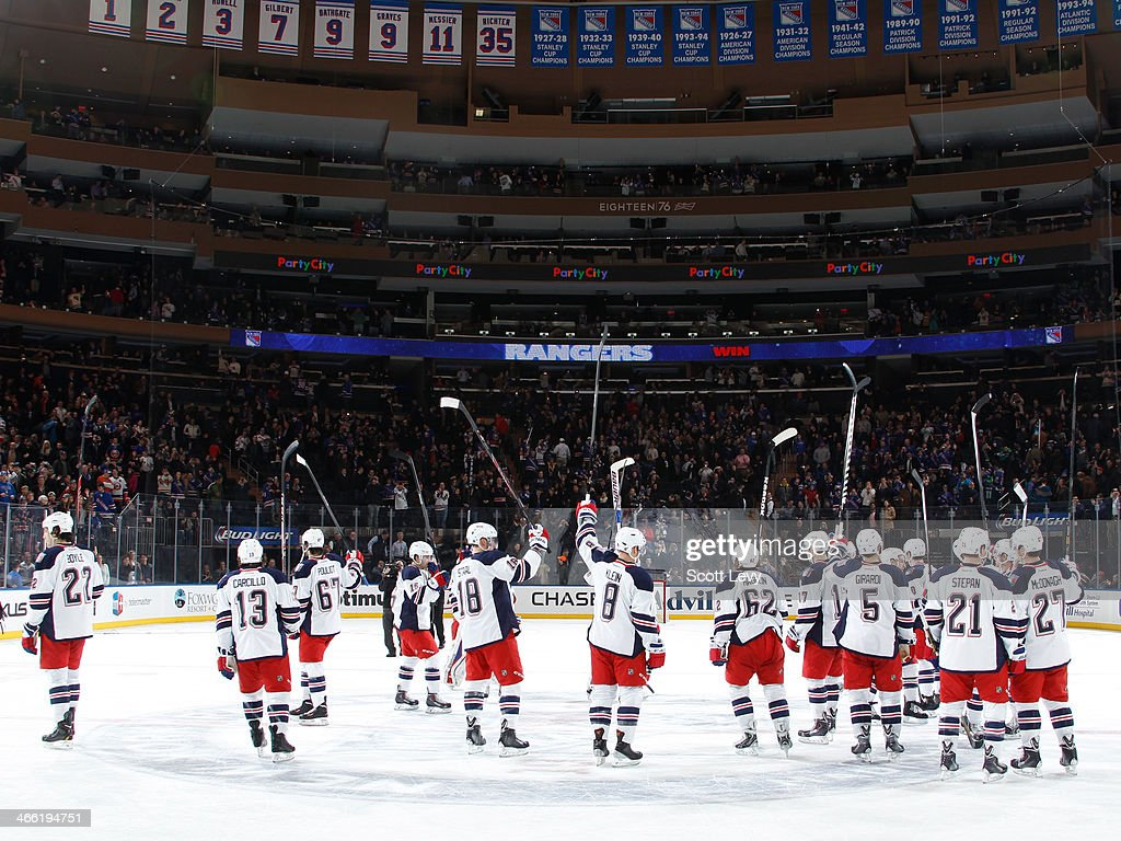 The New York Rangers salute the crowd following a 4-1 win over the the New York Islanders at Madison Square Garden on January 31, 2014 in New York City.