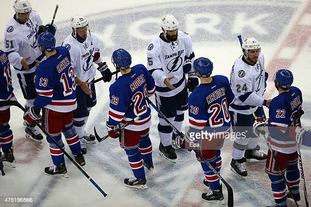 The New York Rangers shake hands with the Tampa Bay Lightning after the Lighting defeated the Ranges by a score of 20 in Game Seven of the Eastern...