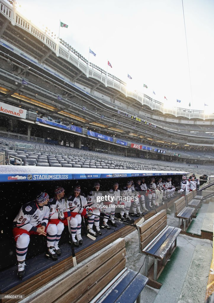 The New York Rangers wait in the dugout for their practice ice to be ready the day before their outdoor game against the New Jersey Devils at Yankee Stadium on January 25, 2014 in the Bronx borough of New York City.