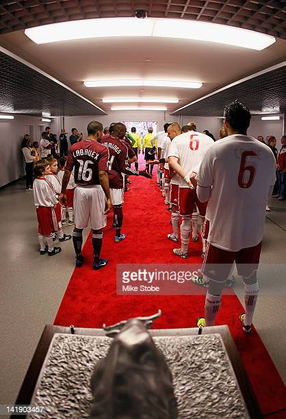 The New York Red Bulls and the Colorado Rapids walk out to the field for the opening ceremonies prior to the start of the game at Red Bull Arena on...