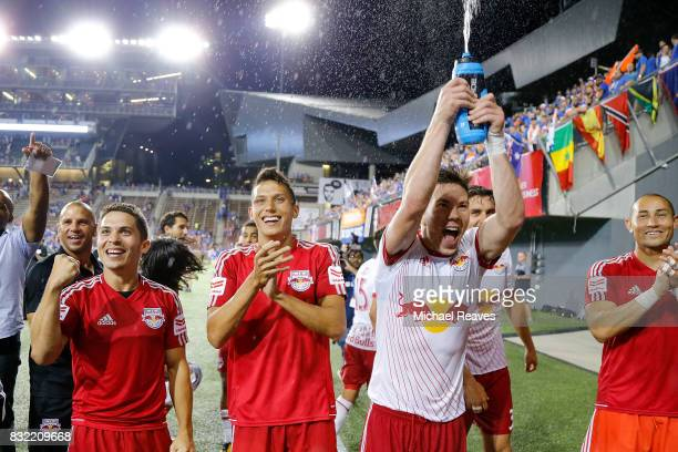 The New York Red Bulls celebrate with fans after defeating FC Cincinnati during the semifinal match of the 2017 Lamar Hunt US Open Cup at Nippert...