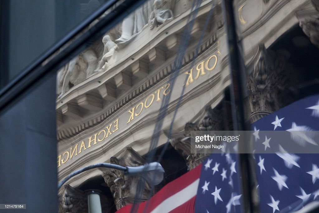 The New York Stock Exchange is reflected in a window on August 19, 2011 in New York City. The Dow ends another volatile week, closing more than 100 points down for the day.