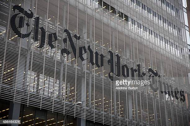 The New York Times building is seen on October 1 2014 in New York City The Times announced plans to cut approximately 100 jobs from the newsroom...