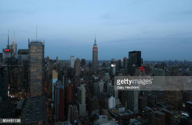 The New York Times building is seen on the skyline of midtown Manhattan along with the Empire State Building in New York City on June 28 2017