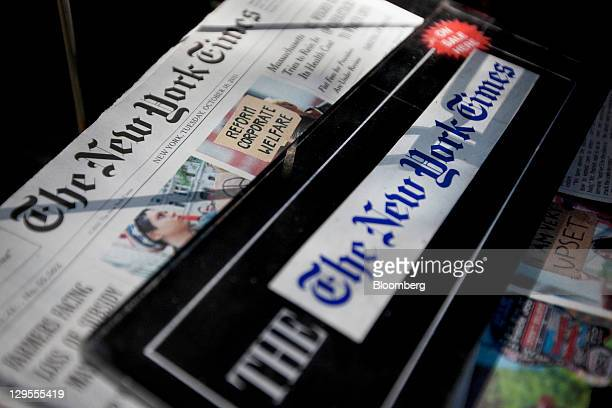 The New York Times Co newspaper is displayed for sale at a newsstand in New York US on Tuesday Oct18 2011 The New York Times Co is scheduled to...