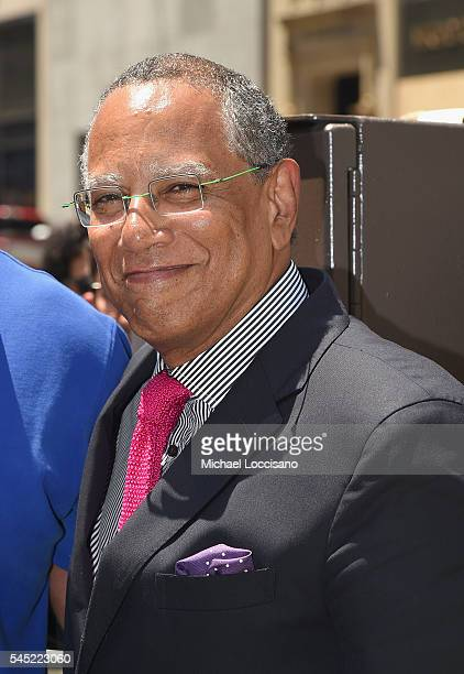 The New York Times Executive Editor Dean Baquet poses as New York City Honors photographer Bill Cunningham with street renaming 'Bill Cunningham...