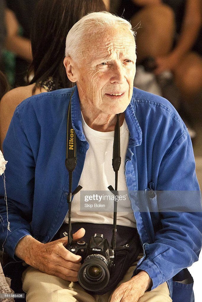 The New York Times fashion photographer Bill Cunningham watches a model on the runway at the Suno spring 2013 fashion show during Mercedes-Benz Fashion Week at Milk Studios on September 7, 2012 in New York City.