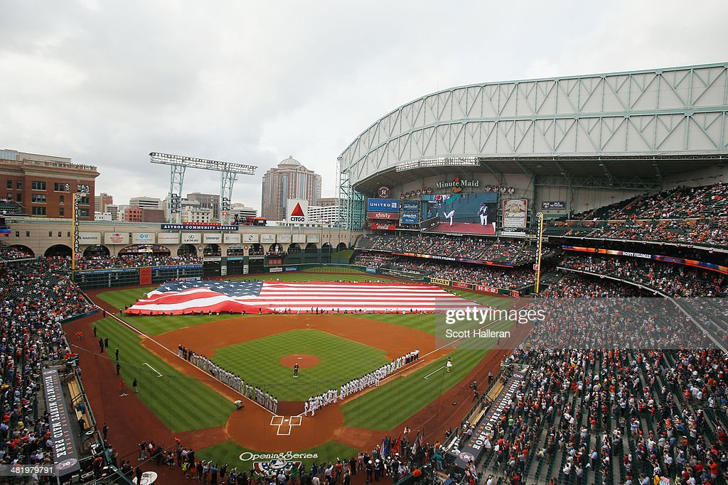 The New York Yankees and Houston Astros teams line up on the field before the start of their game at Minute Maid Park on April 1, 2014 in Houston, Texas.
