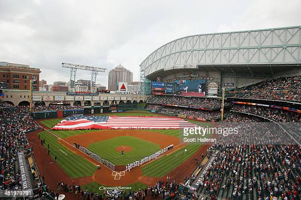 The New York Yankees and Houston Astros teams line up on the field before the start of their game at Minute Maid Park on April 1 2014 in Houston Texas