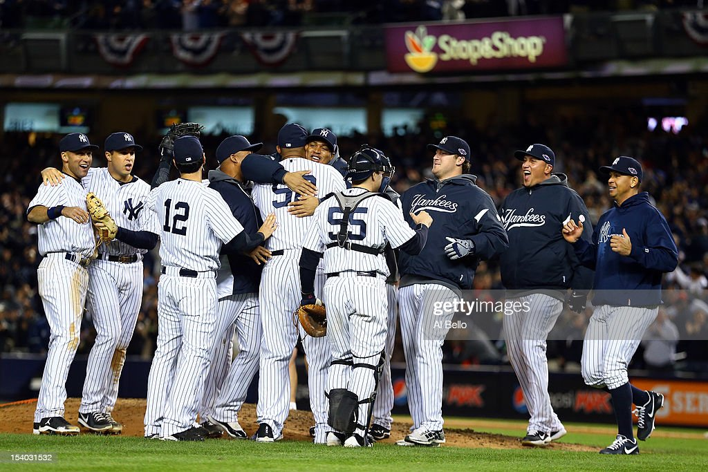 The New York Yankees celebrate after defeating the Baltimore Orioles by a score of 3-1 to win Game Five of the American League Division Series at Yankee Stadium on October 12, 2012 in New York, New York.