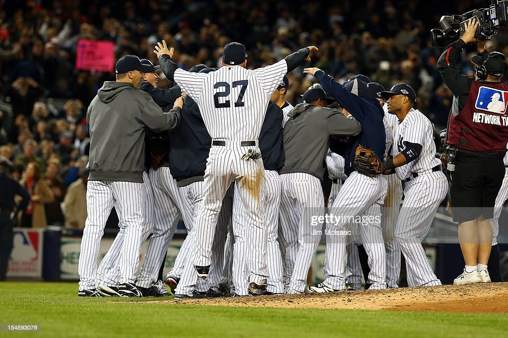 The New York Yankees celebrate after defeating the Baltimore Orioles in Game Five of the American League Division Series at Yankee Stadium on October 12, 2012 in the Bronx borough of New York City. The Yankees defeated the Orioles 3-1 to win their best of five series three games to two.