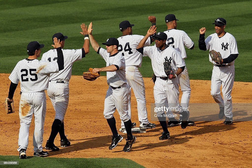The New York Yankees celebrate after defeating the Los Angeles Angels of Anaheim to winn their home opener at Yankee Stadium on April 13, 2010 in the Bronx borough of New York City.