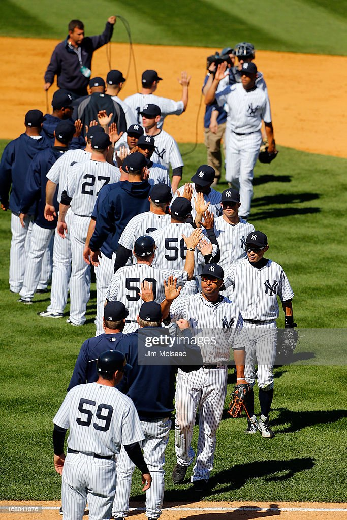The New York Yankees celebrate after defeating the Oakland Athletics at Yankee Stadium on May 4, 2013 in the Bronx borough of New York City.