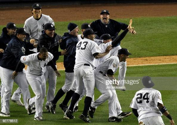 The New York Yankees celebrate after their 73 win against the Philadelphia Phillies in Game Six of the 2009 MLB World Series at Yankee Stadium on...