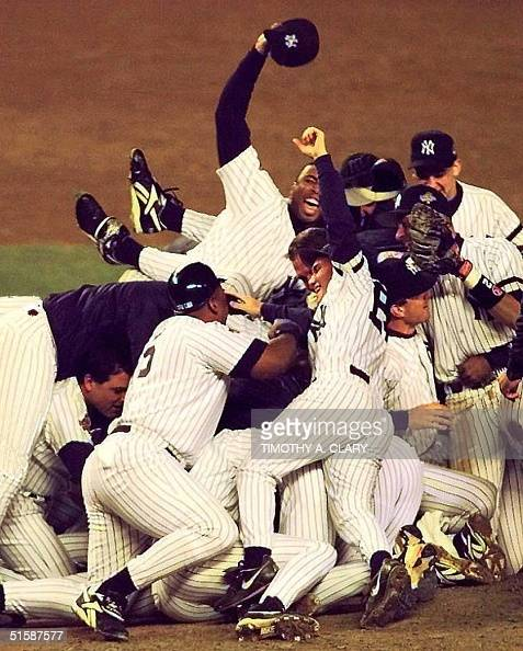 The New York Yankees celebrate on the pitchers mound 26 October after winning game six of the World Series against the Atlanta Braves at Yankee...