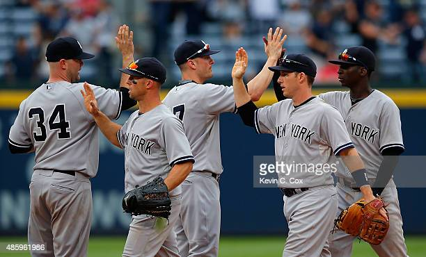 The New York Yankees celebrate their 206 win over the Atlanta Braves at Turner Field on August 30 2015 in Atlanta Georgia