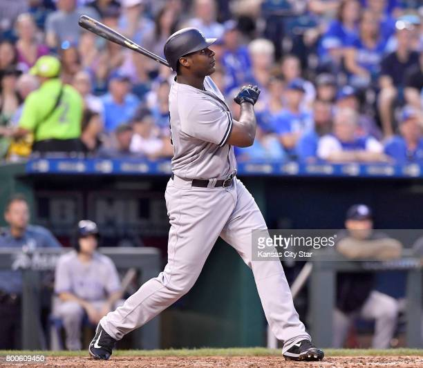 The New York Yankees' Chris Carter follows through on a tworun home run against the Kansas City Royals at Kauffman Stadium in Kansas City Mo on May...
