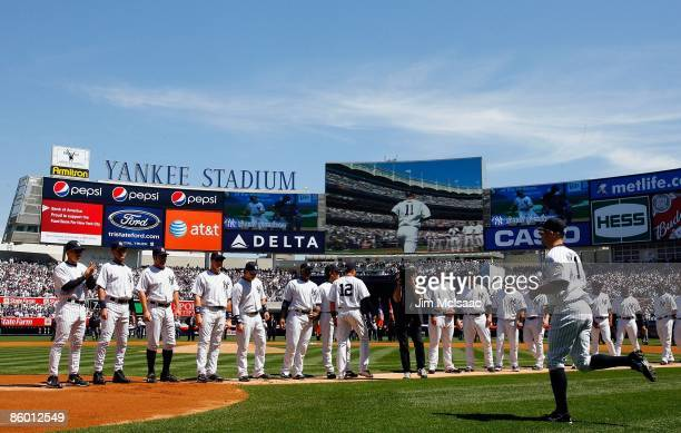 The New York Yankees line up during player introductions prior to theri opening day game against the Cleveland Indians on April 16 2009 at Yankee...