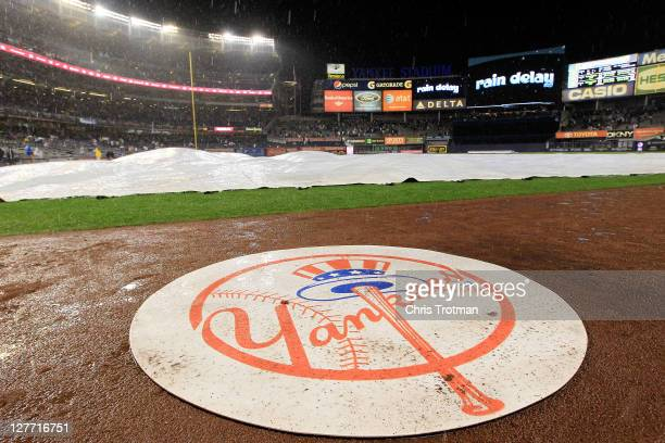 The New York Yankees log is seen during a rain delay during Game One of the American League Division Series at Yankee Stadium on September 30 2011 in...