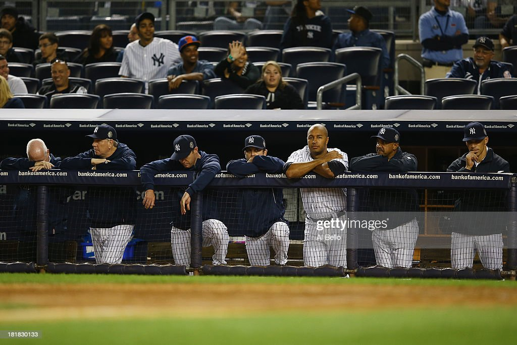 The New York Yankees look on at the end of their 8-3 loss to the Tampa Bay Rays on September 25, 2013 at Yankee Stadium in the Bronx borough of New York City.