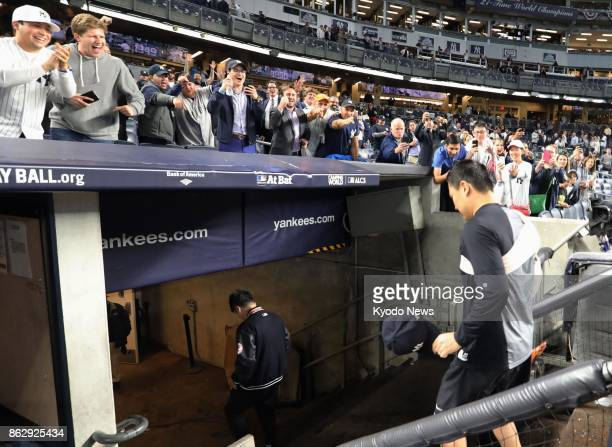 The New York Yankees' Masahiro Tanaka comes off the field at Yankee Stadium to cheers following a 50 Game 5 victory over the Houston Astros in the...