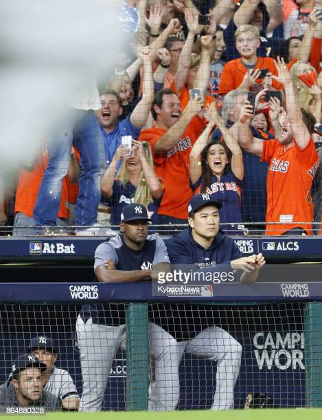 The New York Yankees' Masahiro Tanaka looks stunned next to Luis Severino after the Houston Astros won Game 7 of the American League Championship...