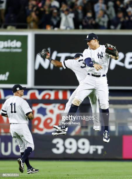 The New York Yankees' outfield of Aaron Judge Brett Gardner and Aaron Hicks celebrate their 64 Game 4 victory of the American League Championship...