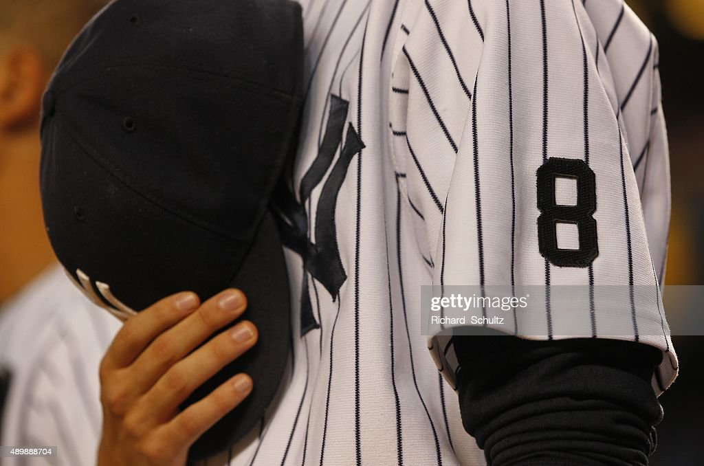 the-new-york-yankees-pause-during-a-mome