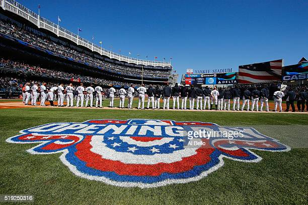 The New York Yankees stand for the National Anthem against the Houston Astros during Opening Day at Yankee Stadium on April 5 2016 in New York City