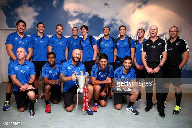 The New Zealand All Black Sevens squad pose for a team photo after arriving back at Auckland International Airport on May 14 2014 in Auckland New...